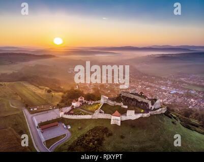 Sunrise in Romania at Fortress Rupea near Brasov and Sighisoara in Transylvania - Stock Image