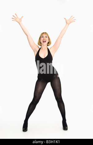 Portrait of young caucasian woman standing cheering with happiness - Stock Image