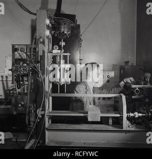 1950s, historical, Leeds University, mad scientist surrounded by equipment in laboratory. - Stock Image