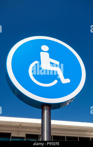 Disabled sign UK. Symbol outside denoting disabled parking. - Stock Image