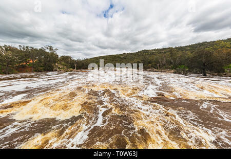 The Swan River in full flow at Bells Rapids after very heavy rain - Stock Image