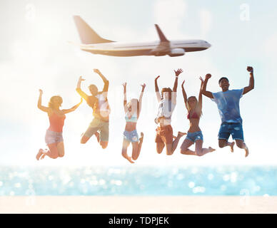 Happy smiling couples playing at the beach with aircraft in the sky - Stock Image