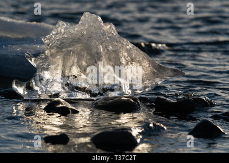 Icebergs in the glacier lagoon of Joekulsarlon, winter in Iceland, Europe - Stock Image