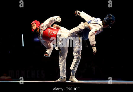 Mexico's Brandon Plaza Hernandez (left) on his way to winning his semi final of the Men's -58kg against Portugal's Rui Branganca, during the World Taekwondo Championships at Manchester Arena. - Stock Image