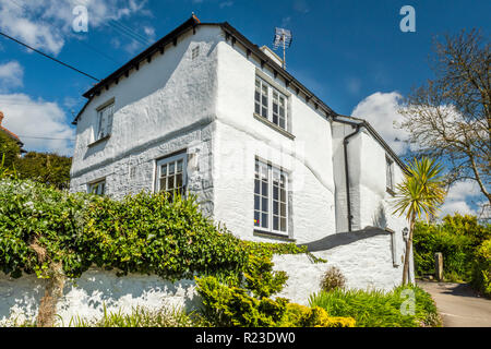 A pretty whitewashed house in the English village of Helford, Cornwall, England - Stock Image