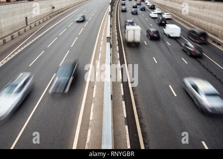 City highway fast traffic in motion at rush hour - Stock Image