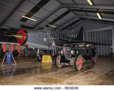 Leicestershire, UK. 19th January 2019. The Vintage Sports Car Club (VSCC) held its annual Measham Rally for vintage and historic cars (pre-1962) covering approximately 160 miles in the Leicestershire countryside. Before the event got underway at 9.30pm each car had to pass a scrutineering check carried out in an aircraft hanger at Bruntingthorpe Aerodrome and Proving Ground, formally a US Airforce base, now the largest privately owned vehicle test track facility in the UK and home to the historic Cold War Jets Collection (three English Electric Lightning a Credit: Gary Clarke/Alamy Live News - Stock Image