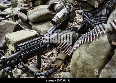 United States Army ranger machine gunner in the forest. - Stock Image