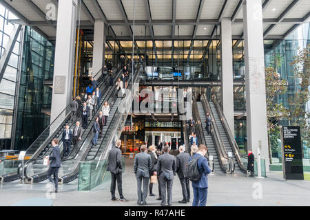 Bowellism architecture, business people, crowd, escalators, iconic london skyscrapers, Inside-Out Building, insurance, london financial district, London uk, Loyds Building, Loyd's Building, The Aon Centre, The Leadenhall Building - Stock Image