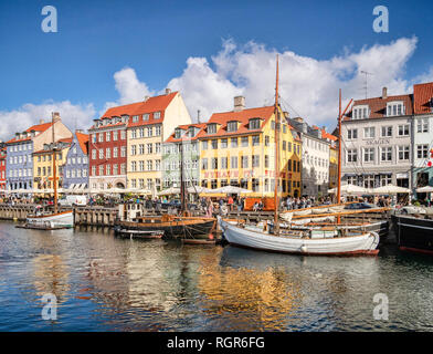 23 September 2018: Copenhagen, Denmark - The waterfront at Nyhavn, formerly a working harbour and now a tourist and leisure area with historic... - Stock Image