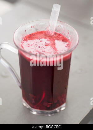 Mug of warm mulled wine: A mug of hot mulled wine with fruit from an Austrian Christmas market. - Stock Image