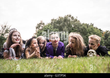 Children dressed as zombies for Halloween Night. - Stock Image
