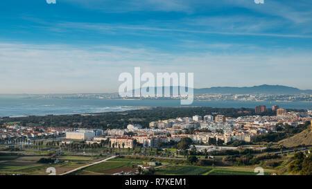 High perspective view of Greater Lisbon from Miradouro Aldeia dos Capuchos in Costa de Caparica, Almada. Palacio Pena in Sintra is visible - Stock Image
