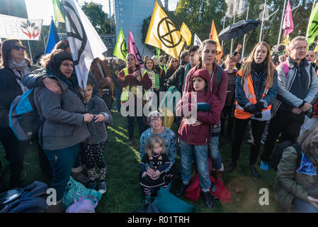 London, UK. 31st October 2018. People at the Extinction Rebellion protest in Parliament Square hears speeches from climate activists including  Swedish schoolgirl Greta Thunberg, campaigner Donnachadh McCarthy, Labour MP Clive Lewis and economist and Green MEP Molly Scott Cato before making a 'Declaration of Rebellion' against the British Government for its criminal inaction in the face of climate change catastrophe and ecological collapse. Credit: Peter Marshall/Alamy Live News - Stock Image