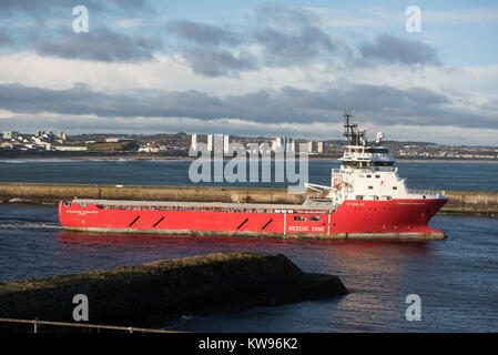 The Offshore supply vessel Standard Princess leaving Aberdeen city docks for the North Sea. - Stock Image