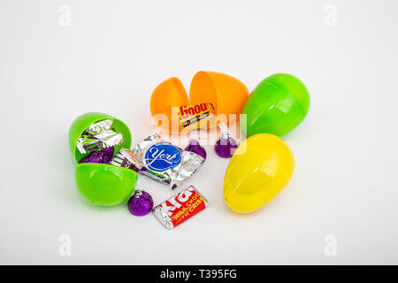 Colorful Plastic Easter Eggs with Wrapped Candy - Stock Image
