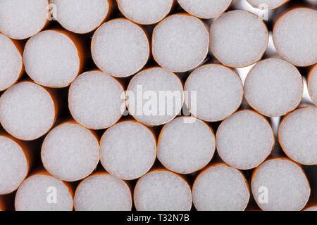 Lots of tobacco cigarettes with filter. - Stock Image