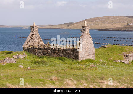derelict croft house overlooking Loch Roag on the Isle of Lewis - Stock Image