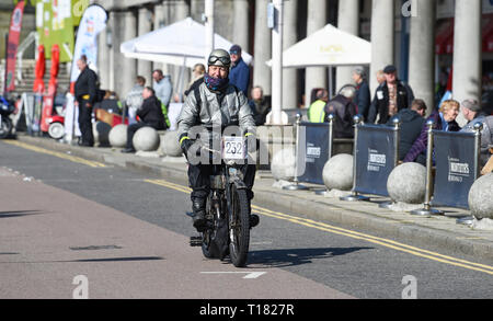 Brighton, UK. 24th March 2019. Stephen Chapman on a 1911 Triumph nears the finish of the 80th Anniversary Pioneer Run for pre 2015 veteran motorcycles in Brighton . The run organised by the Sunbeam Motor Cycle Club begins on the Epsom Downs in Surrey and finishes on Madeira Drive on Brighton seafront Credit: Simon Dack/Alamy Live News - Stock Image