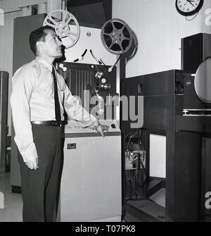 1960s, film technician with news reels and equipment, saudi Arabia. - Stock Image