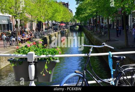 View of canal on a sunny spring day in the town centre of the stunning historic Dutch town of Delft, Holland, Netherlands - Stock Image