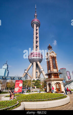 1 December 2018: Shanghai, China - Oriental Pearl Tower and Disney Store clock tower in the Pudong districtof Shanghai. - Stock Image