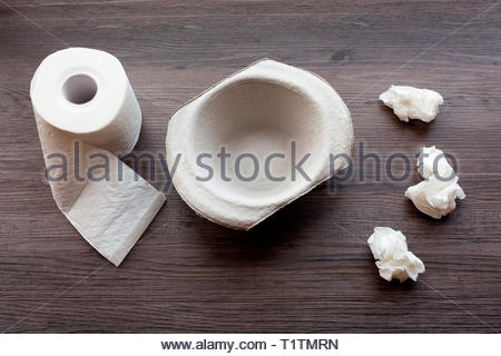 Cardboard sick bowl with toilet roll and tissues - Stock Image