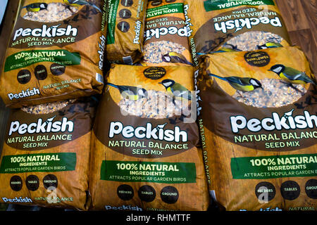 A stack of large bags of Peckish brand wild bird food for sale in a garden centre in North Yorkshire England - Stock Image