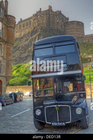 The black London Necrobus, in Edinburgh, Scotland, UK with castle behind. - Stock Image
