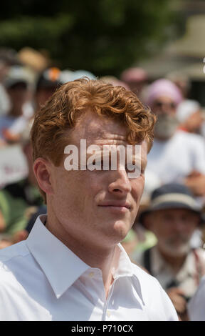 U.S. Democratic Representative Joseph Patrick Kennedy III (Joe Kennedy), grandson of Robert Kennedy and grand-nephew of John F. Kennedy at Boston City Hall during the Rally against Family Separation in Boston, MA. Kennedy had spoken against U.S. President Donald Trump's policy of detaining immigrants and separating immigrant families.  Large rallies against President Trump's policy of separating immigrant families took place in more than 750 U.S. cities on June 30th of 2018. - Stock Image
