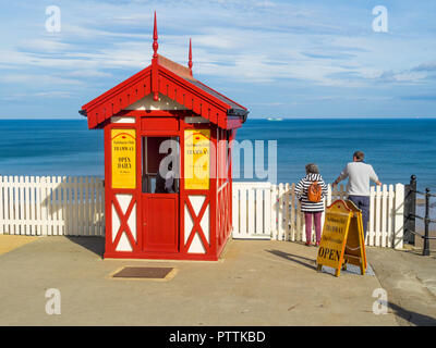 The top station of the Saltburn Cliff Funicular tramway with a man and woman looking down at the pier - Stock Image