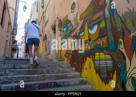 Marseille, FRANCE, Man Walking on Street, Front of Building, Old CIty Center, Tourists Visiting Neighborhood, Street Art on Display in old Neighborhood, the Panier - Stock Image