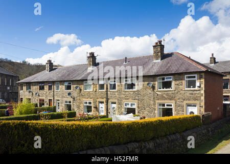 Terraced Houses in Walsden near Todmorden. These particular houses are constructed in a mix of brick and stone. - Stock Image