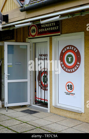 exterior of a hungarian government approved and licensed shop for selling tobacco products zala county hungary - Stock Image