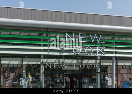 Frontage of New Look, a UK fashion retailer; Rushden Lakes, Northamptonshire, England - Stock Image