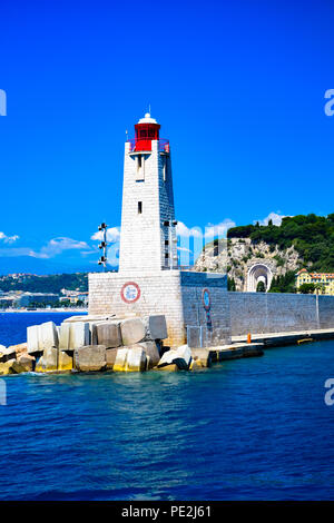 Light house guarding the entrance to Nice Harbor on the Cote D'Azur in France - Stock Image