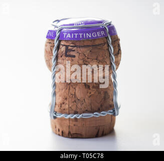 Taittinger Champagne cork, wire and foil on a white background - Stock Image