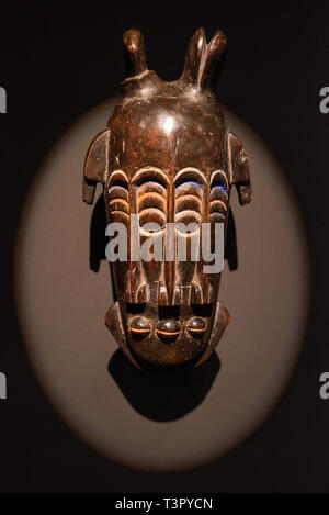Tenerife, Spain - February 8 2019 : African tribal wooden hand carved mask at African tribal culture exhibition . - Stock Image