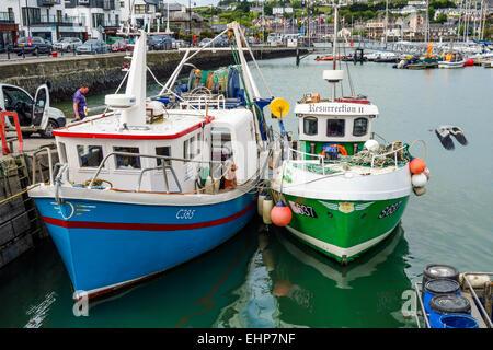 Fishing boats alongside at Kinsale Harbour, Ireland. - Stock Image