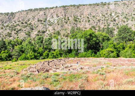 Canyon and old stone ruins at Main Loop trail in Bandelier National Monument in New Mexico during summer in Los Alamos - Stock Image