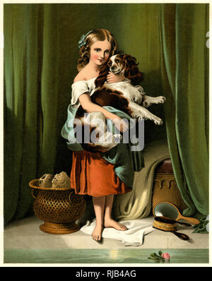 A girl holds her spaniel. - Stock Image