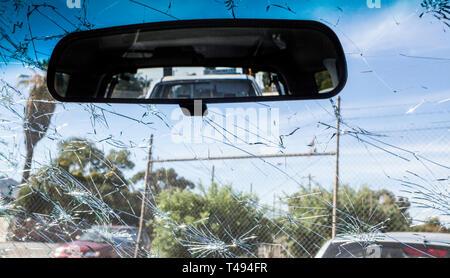 Hailstone damage on the front windscreen of a car - Stock Image