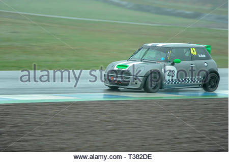 Dunfermline, UK. 7th April, 2019.   43 Stuart BuchanÕs Cooper S during qualifying for a Scottish Fiesta/Mini Cooper S Cup  race at Knockhill Circuit. During a wet and misty start to the Scottish Championship Car Racing season organised by the SMRC (Scottish Motor Racing Club) at Knockhill. Credit: Roger Gaisford/Alamy Live News - Stock Image