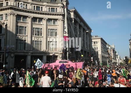 Extinction Rebellion demonstrators at Oxford Circus in London. - Stock Image