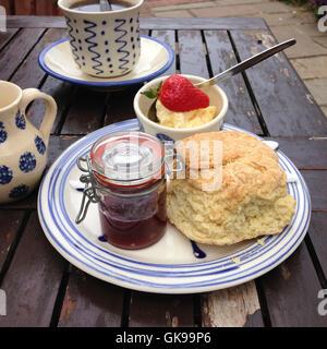 cream tea, Scone, jam and clotted cream - Stock Image