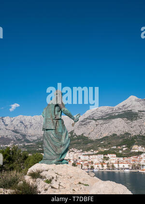 Editorial - Statue of Saint Peter with key in hands in Makarska on sunny day - Stock Image