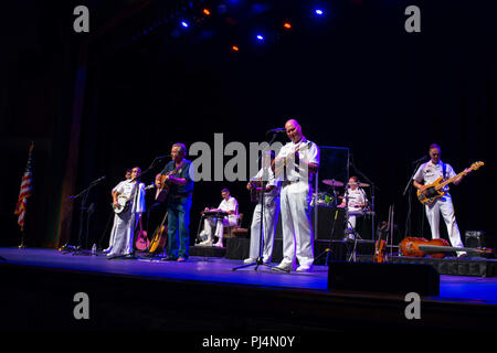 180830-N-NW255-1011 FRANKLIN, N.C. (Aug. 30, 2018) The U.S. Navy Band Country Current performs for a packed house at the Smoky Mountain Center for the Performing Arts,  joined by a former band member, retired Musician 1st Class Ben Winter. Country Current is on a 1,600 mile tour through Virginia, North Carolina, Georgia and Florida, which allows Navy musicians to entertain audiences in parts of the country that don't often get to see the Navy at work. (U.S. Navy photo by Senior Chief Musician Melissa Bishop/Released) - Stock Image