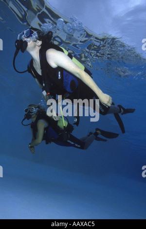 SCUBA diver training in swimming pool - Stock Image
