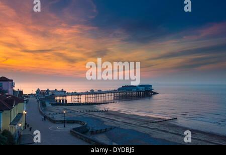 Cromer pier at sunset. - Stock Image