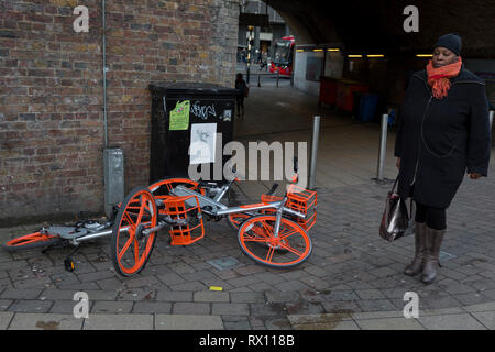 A potential trip hazard for passers-by as a pile of three abandoned dockless Mobikes are left in the street near Waterloo Station, on 4th March 2019, in London England. - Stock Image